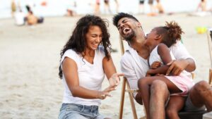 happy family with natural spf on beach